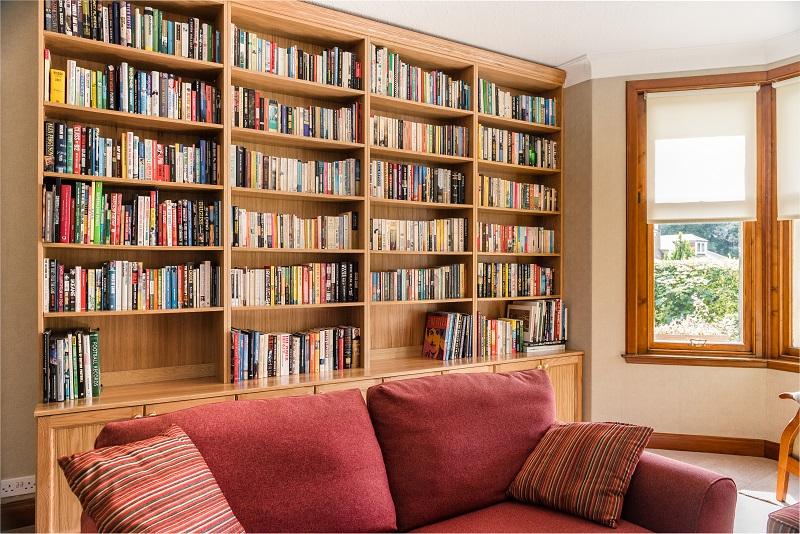 Solid oak bookcase with alcove cabin