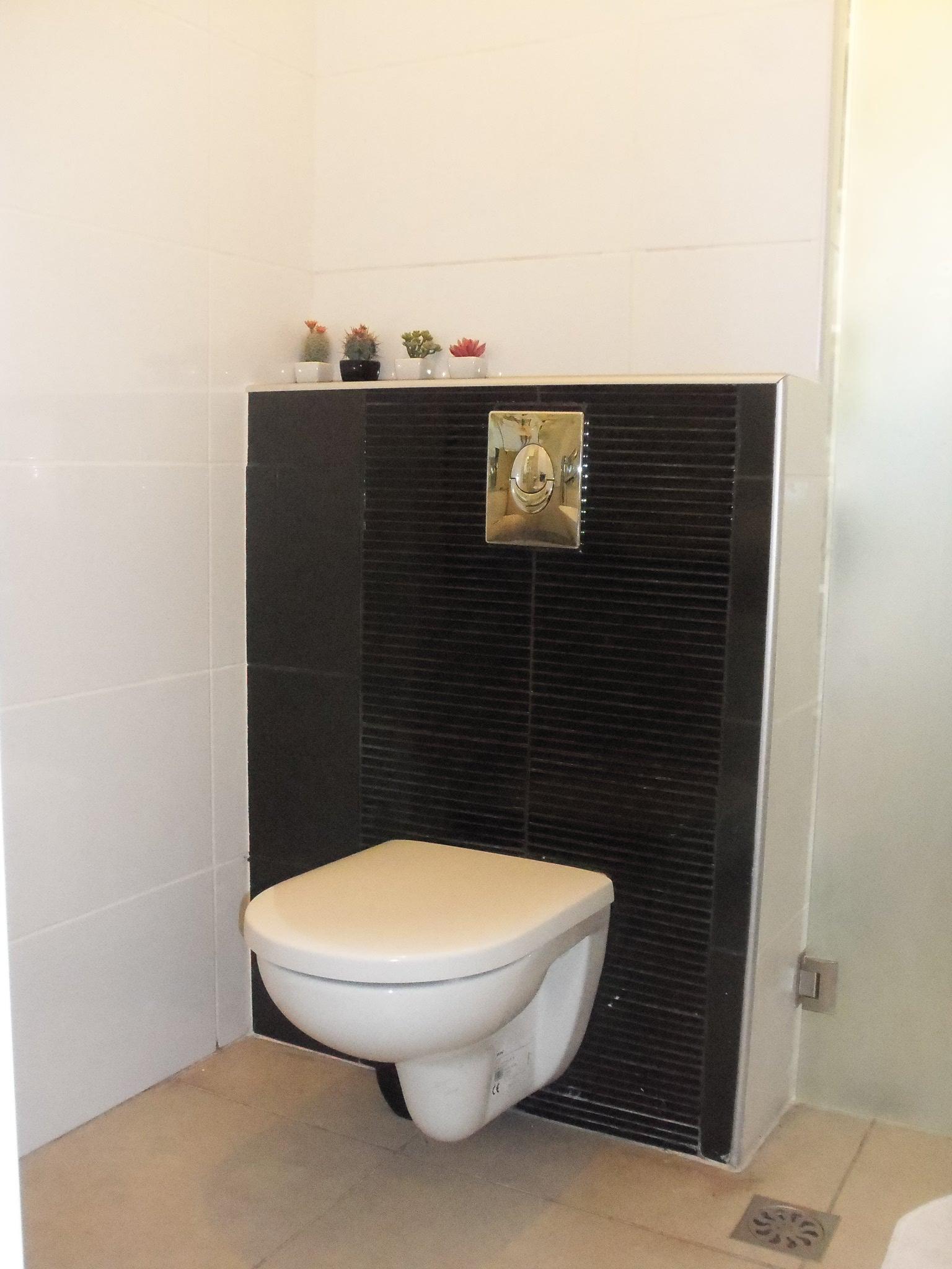 ריצוף חדרי אמבט ושירותים