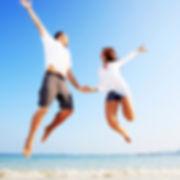 Couple jumping on the beach 2_edited.jpg