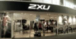 illuminated signage for 2xu, light boxes, fabric light boxes, fabricated letters, LED lettering, Neon, cantilevered light boxes, acrylic light boxes