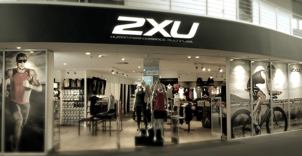 illuminated signage for 2xu, light boxes, fabric light boxes, fabricated letters, LED lettering, Neon, cantilevered light boxes, acrylic light boxes