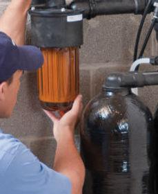 Service-Technician-Inspecting-Softener-L