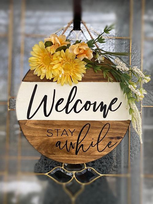 Wooden welcoming door sign