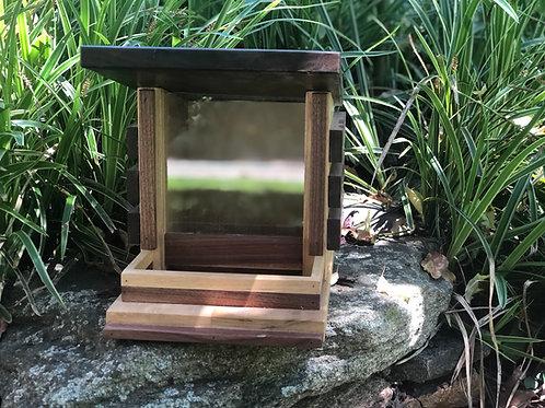 Walnut and popular bird feeder
