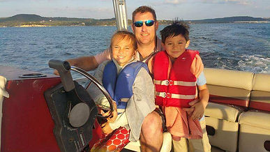 With kids on boat.jpg
