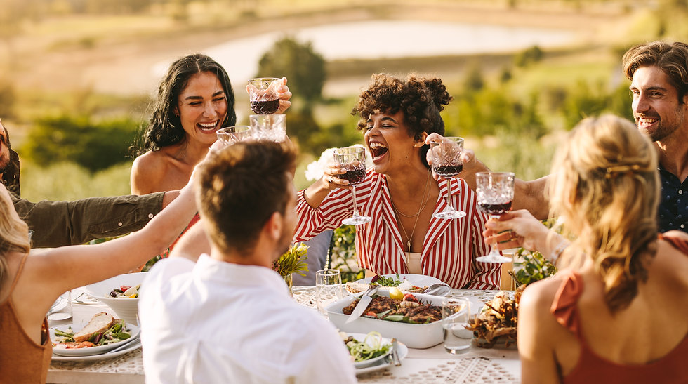 Group of cheerful friends having wine at