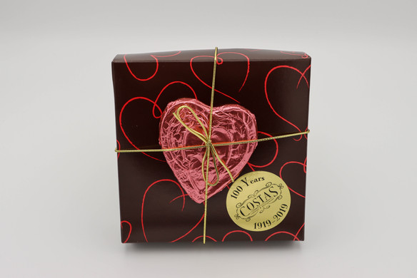 Chocolate heart tied to front of candy assortment