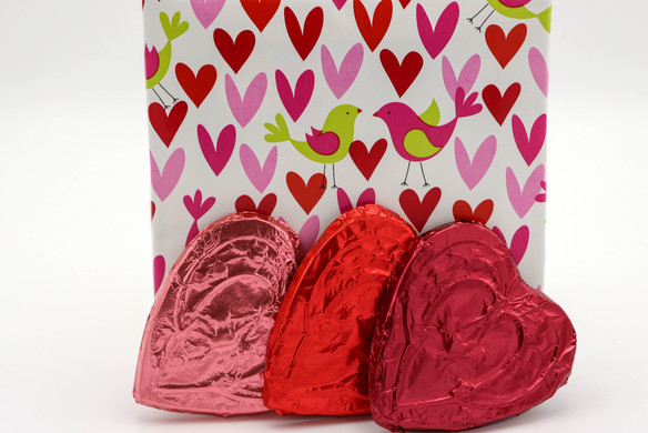 Valentine's Day wrapping paper and chocolate hearts