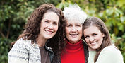 Three generations of white women smiling.