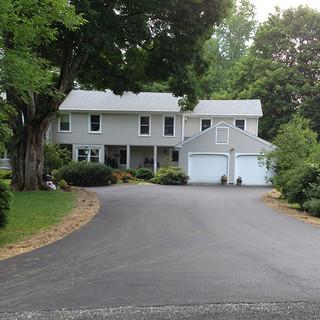 Grey House Asphalt Driveway