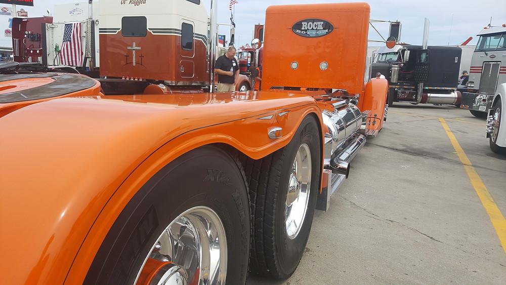 Long custom fenders, pinstriped black on orange fiberglass.