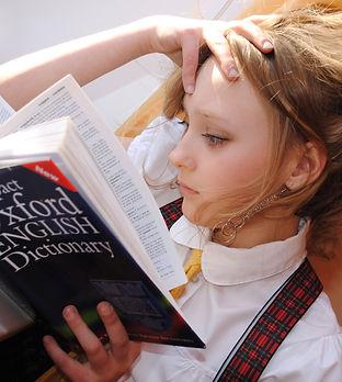Canva - Girl Reading Dictionary.jpg