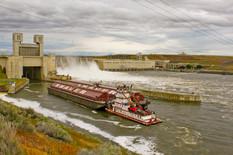 Breaching Snake River Dams_Barge sailing