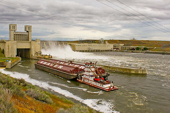 Breaching Snake River Dams_Barge sailing