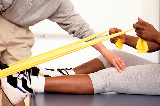 manual physical therapy session using resistance band