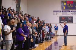 """Alumni singing """"National Anthem"""" at basketball game"""