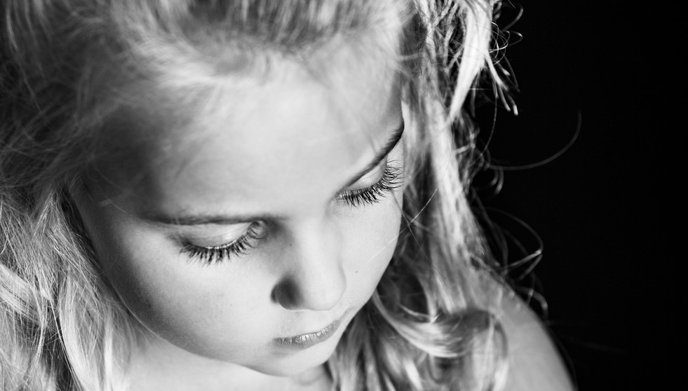 Girl with long eyelashes in black and white