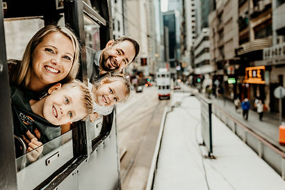 Family of four riding the tram in Central