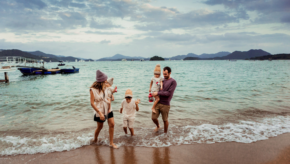 Family of five having fun at the beach
