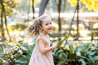 Curly hair girl twirling around