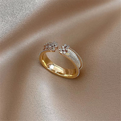 Gold plated ring with zircons