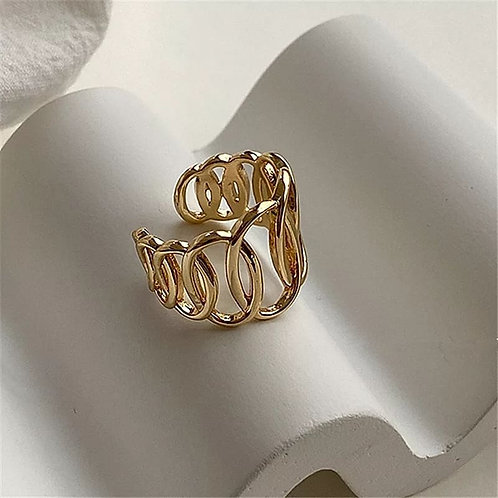 Gold plated ring with unusual shape