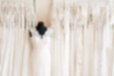 Many wedding dresses in atelier.jpg Back