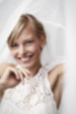 Beautiful bride smiling at camera.jpg