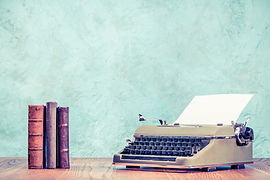 Retro classic typewriter with sheet of p