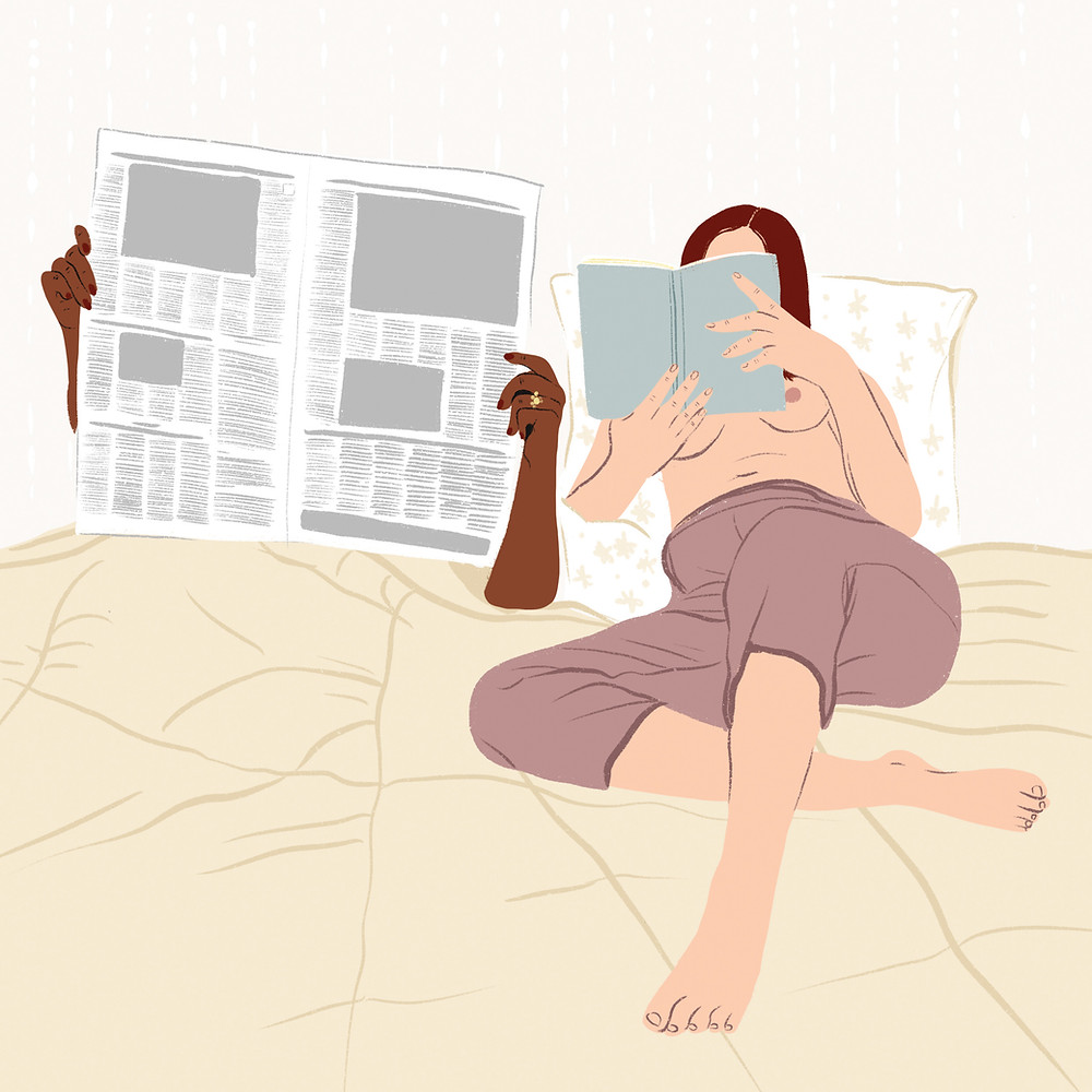 Lady topless in Bed reading a book