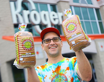 adam holding bread.png