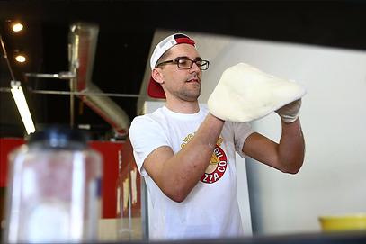 adam making a pizza.png