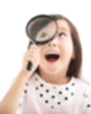little girl looking through a magnifying