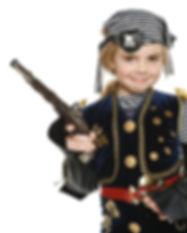 Little girl wearing pirate costume holdi