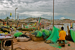 Tools: Canon EOS Rebel T2i DSLR, Photoshop  Cape Coast, Ghana  A typical day for fishermen in Cape Coast. Beautiful brightly colored netting to bring in the catches of the day.