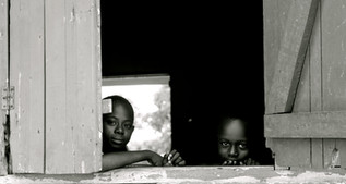 Cape Coast, Ghana  Local primary school children. These two children, amongst many others, greeted the team of fellows daily as we trekked on our 20 minute walk through the village to catch a tro-tro. These two particular kept me motivated to continue on with my research for the day.    Tools: Canon EOS Rebel T2i DSLR, Photoshop