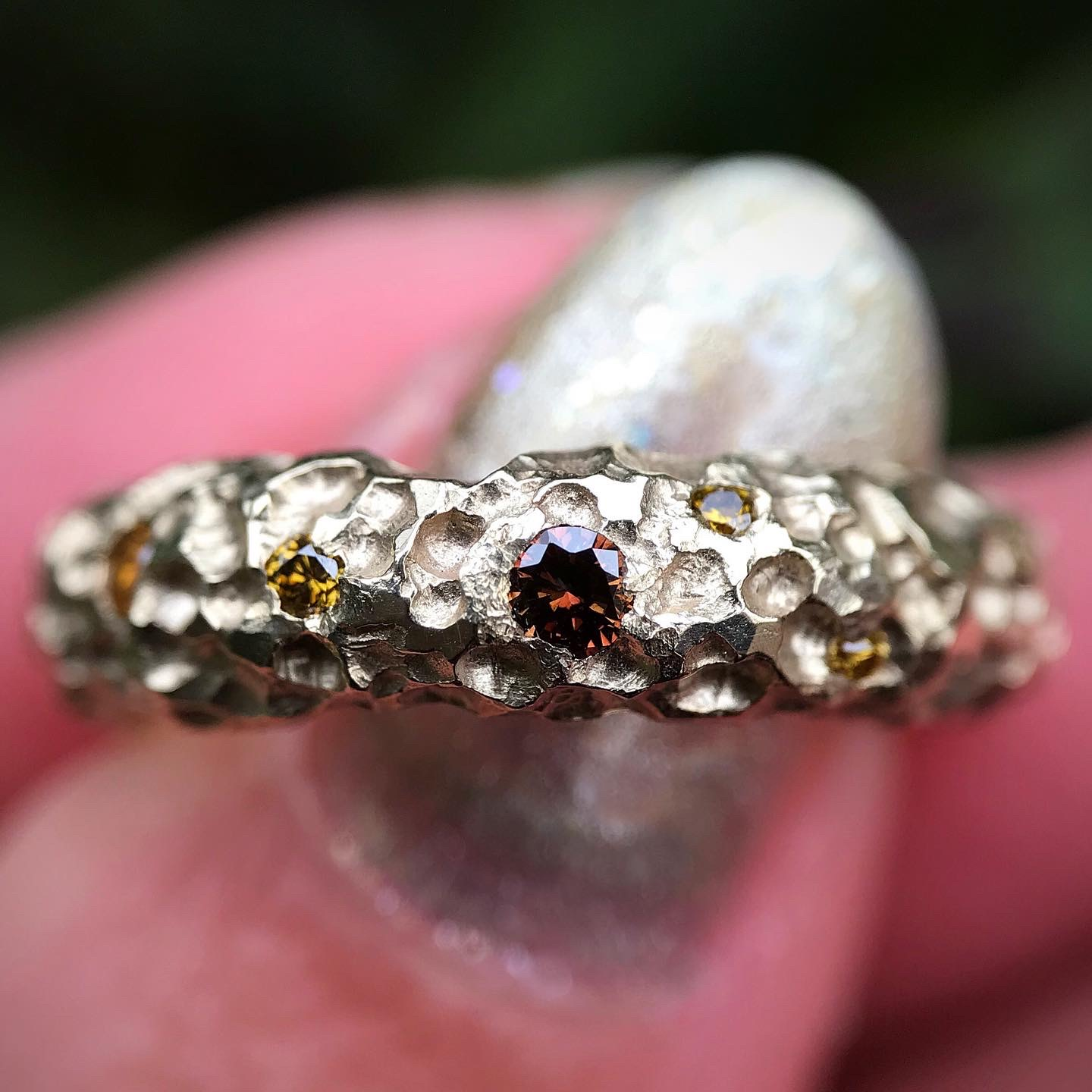 Hand carved alternative bridal 14k yellow gold engagement ring with organic texture and 15 champagne