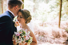 Bride and groom in a park kissing.couple