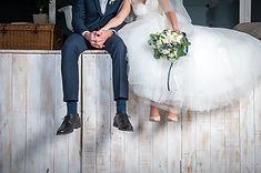 Beautiful wedding couple sitting on wood