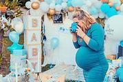 Pregnant woman taking photos of a decora