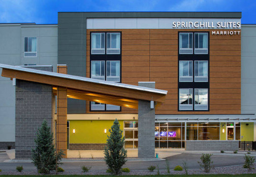 Front Entry with Wood Beams and Concrete Structure | Kertusha Painting | Marriott Hotel Kalispell MT