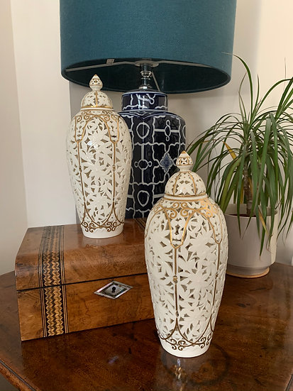 Pair of Grainger Worcester pierced vases with covers.