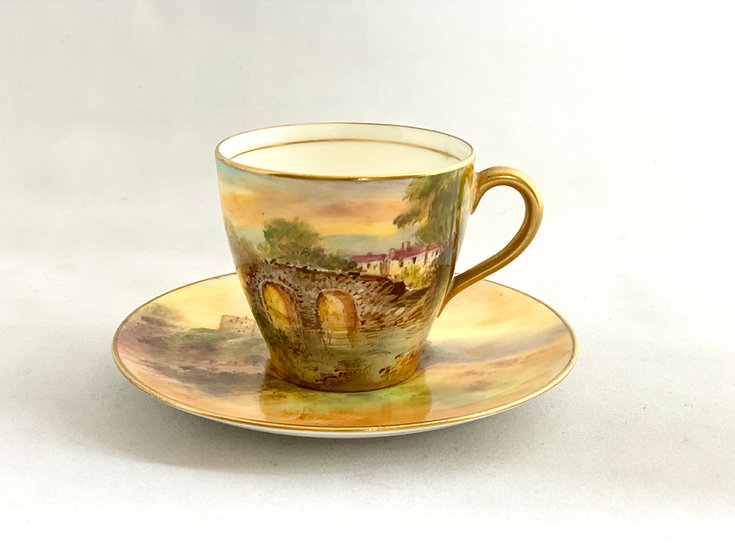 Royal Doulton demitasse coffee cup painted with scenes