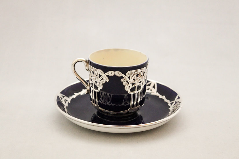 Minton coffee cup and saucer with silver overlay