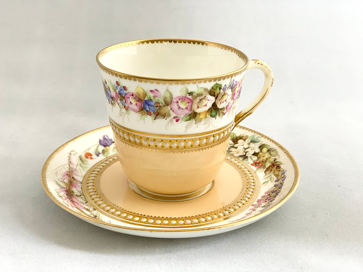 Royal Worcester jewelled tea cup and saucer