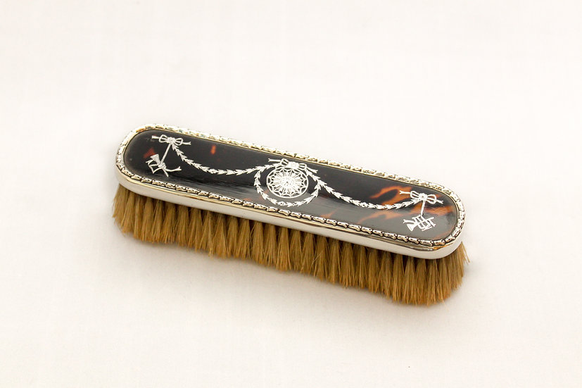 Silver piqué and tortoiseshell clothes brush