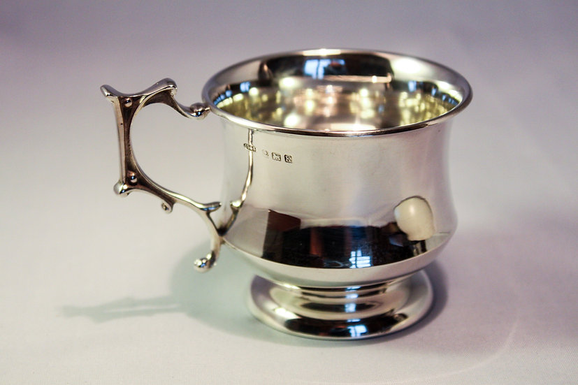 Silver cup with gothic revival handle