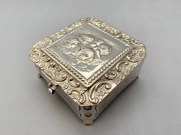 Silver jewellery box with lid depicting 'Reynold's Angels'