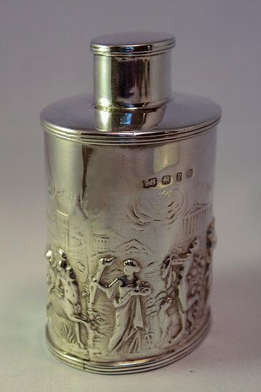 Silver tea caddy withe Grecian scene