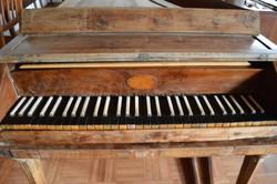 The piano's case has yew veneer